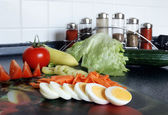 Kitchen and vegetables — Stock Photo