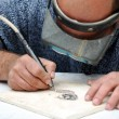 Stock Photo: Engraver in stone table