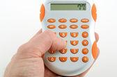 Calculator in hand — Stock Photo
