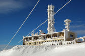 TV transmitter on snowy mountains — Stok fotoğraf