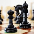 Chess pieces on wood board — Stock Photo #6596506