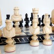 Chess pieces on wood board — Stock Photo #6596529