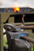 Blacksmith tools two hammer and anvil, backround fire — Stock Photo