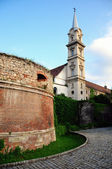 Church in Sopron and old historic walls — Stock Photo