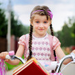 Young school girl rides her pink bicycle — Stock Photo #6483636