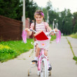 Young school girl rides her pink bicycle — Stock Photo #6483637