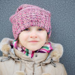 Portrait of child girl in warm autumn clothes — Stock Photo