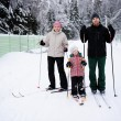 Young parents and their daughter do Nordic skiing - Stock Photo
