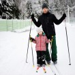 Stock Photo: Young father and daughter do Nordic skiing