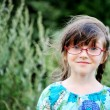 Portrait of adorable child girl in glasses — Stock Photo