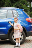Young girl with pink backpack ready to go to school — Stock Photo