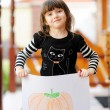 Young girl outdoors acts as a black cat on Halloween — Stock Photo #6514230