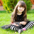 Young girl poses outdoors as a witch on Halloween — Stock Photo