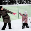 Royalty-Free Stock Photo: Young mother and daughter have fun in the snow