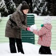 Young mother and daughter have fun in the snow — Stock Photo