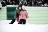 Winter portrait of young mother and daughter — Stock Photo