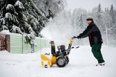 A man operating snow blower in winter — Stock Photo