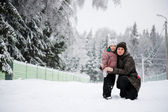 Winter portrait of young mother and daughter — Стоковое фото