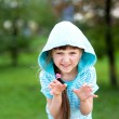 Cute child girl poses outdoors with scary face — Stock Photo