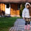 Cute child girl with long dark hair poses outdoors — Stock Photo #6616201