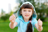 Outdoor portrait of cute child girl in blue jacket — Stock Photo