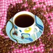 Stock Photo: Cup of cofee with cofee beans