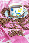 Cup of cofee with cofee beans — Stock Photo
