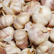 Stock Photo: Close up of garlic on market stand