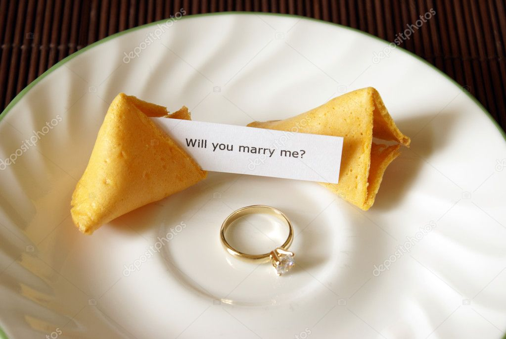 A marriage proposal using a fortune cookie and gold ring. — Stock Photo #6487166