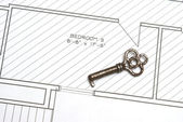 Old Key and Blueprints — Stock Photo