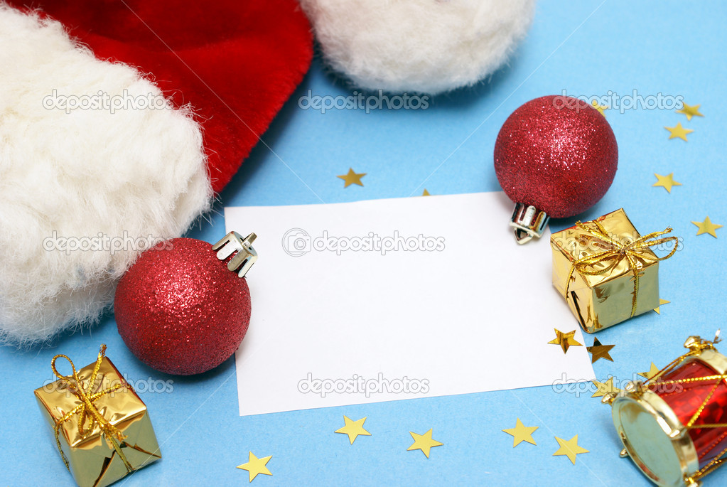 A blank Christmas note with various decorations and a Santa hat. — Stock Photo #6717631