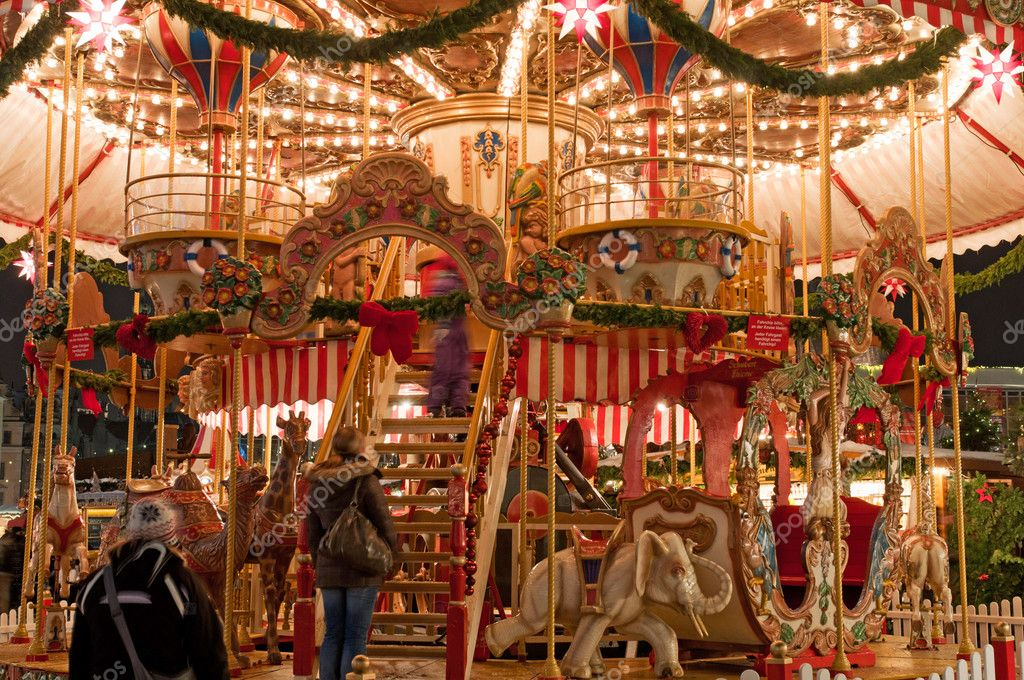 Children merry-go-round at Christmas market in Dresden, Germany.  Stock Photo #6604419