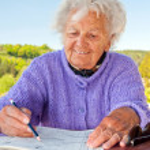 Senior Woman Doing a Crossword — Stock Photo #6693733