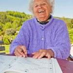 Senior Woman Doing a Crossword — Stock Photo #6693923