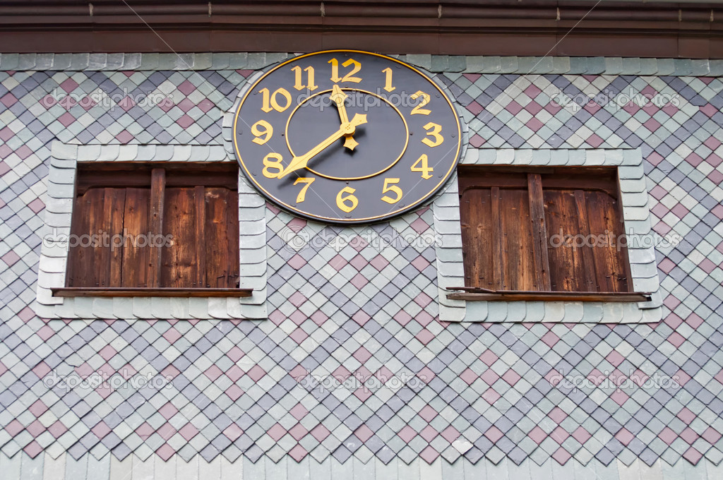 View of medieval clock on the outside of the church in Czermna, Poland. — Stock Photo #6732375