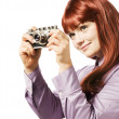 Young woman taking picture with a retro camera — Stock Photo