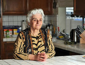 Portrait of a senior woman in the kitchen — Stock Photo
