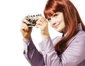 Young woman taking picture with a retro camera — ストック写真