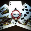 Poker suit royal flush of spades with poker chip — Stock Photo