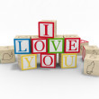 Wooden toy blocks spelling I love you — Stock Photo