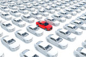 One red car with hundreds white — Stock Photo