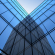 Ultramodern glass facade and sky. — Stock Photo