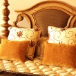 colorful cushions on the bed — Stock Photo