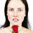 Beautiful brunette woman with a rose — Stock Photo #6599157