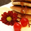 Stack of flapjacks with syrup — Stock Photo #6599420