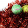 Two bauble balls in red tinsel - Stock Photo