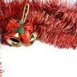 Christmas bells in red tinsel - Stock Photo