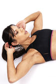 Beautiful brunette woman exercising — Stock Photo