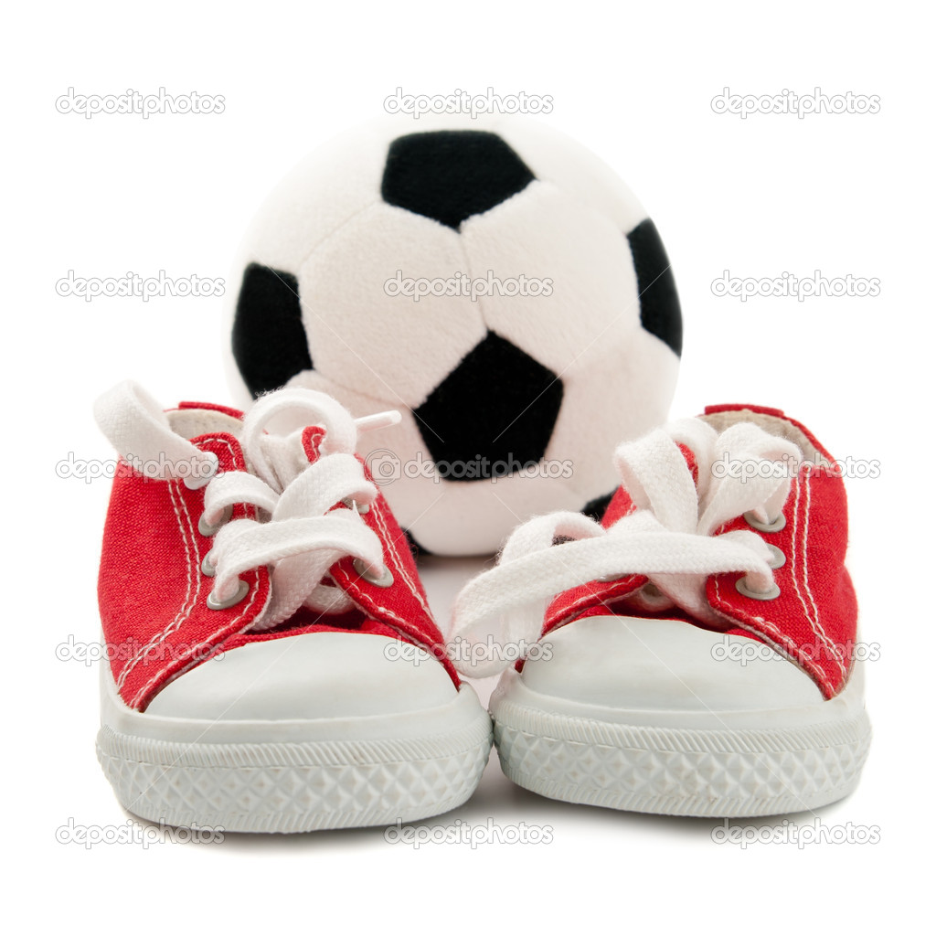 Red baby sneakers with a ball isolated on white background  — Stock Photo #6500651