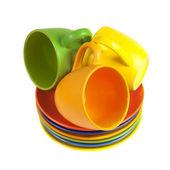 Conjunto de copos coloridos e pires — Foto Stock